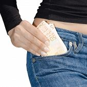 Woman's Hand Holding A Bundle Of Banknotes Isolate