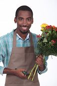 florist with bouquet of flowers on white background