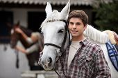 Young man looking after horses