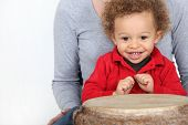Little boy sat by bongo drum