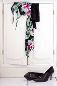 Colorful Dress And Black Stockings On White Closet