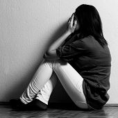 image of suicide  - Depressed teenage girl cover the face with her hands - JPG
