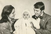 stock photo of christening  - Vintage photo of parents and daughter  - JPG