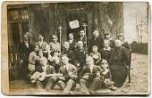KALISZ, POLAND,CIRCA 1935: group of unidentified people, men, women, children pose for a photo. An e