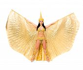 Young beautiful belly dancer in a gold costume