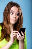 Woman Texting While Looking Surprised On Phone