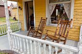 Old Rocking Chairs On Porch