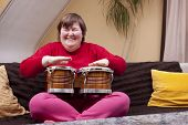 Mentally Disabled Woman With Music Therapy