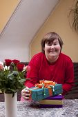 picture of physically handicapped  - a Mentally defective woman holding many gifts - JPG