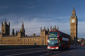 Houses Of Parliament With Red Bus In London