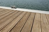 picture of pontoon boat  - Detail of a wooden floating dock with mooring bitts - JPG