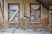 Old Abandoned House Brick Wall With Covered Windows