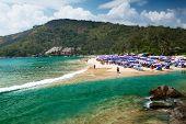 Tropical beach with a lot of umbrellas. Nai Harn beach, Phuket, Thailand