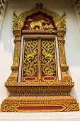 Golden Ornament Wooden Window Of Thai Temple In Chiangmai , Thailand