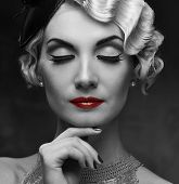 Monochrome portrait of elegant blond retro woman   with beautiful hairdo and red lipstick