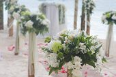 wedding arch, flower posts and decoration on beach