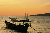 Silhouette Of Traditional Fishing Boat At Sunrise, Koh Rong Island, Cambodia