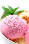 Strawberry fruit ice cream with mint on white