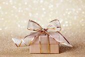Christmas gift box on golden background