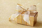 Christmas gift box on golden background