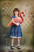 stock photo of alice wonderland  - Alice trying to play croquet with flamingo - JPG