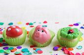 Marzipan pig,mushroom and cloverleaf on white background
