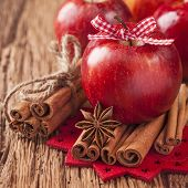 Red winter apples with cinnamon sticks and anise