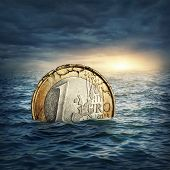 foto of collapse  - Euro coin sinking in water - JPG