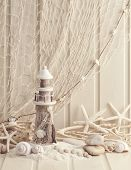 stock photo of fishnet  - Marine life decoration and on wooden shabby background - JPG