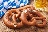 German bretzels and beer on wooden table