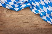 foto of bavaria  - Oktoberfest blue checkered fabric on wooden background - JPG