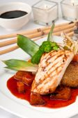 foto of mahi  - Plate of Mahi Mahi severd with vegetables pineapple and soy sauce.