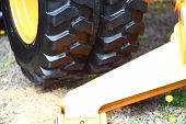 image of dozer  - Detailed view of heavy vehicle big wheel of the building dozer or other construction machinery - JPG