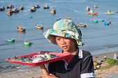 Unidentified Young Seller In Fishing Village. Mui Ne. Vietnam