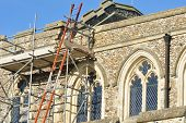 pic of church-of-england  - Church being repaired with scaffolding and ladder - JPG
