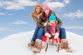 family sliding winter couple enjoying season