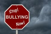 image of stop bully  - An American road sign and words Stop Bullying Now with stormy sky background Stop Bullying Now Sign - JPG