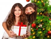 Closeup portrait of cheerful young family celebrating New Year holidays, receive present, happy Christmastime party, Merry Christmas concept