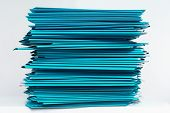Stacks Of Cyan Folders Over White Background