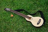 Mini Guitar For Travel On Lawn