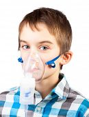 Portrait of cute boy using nebulizer on white background