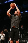 BROOKLYN, NY-APR 22: Brooklyn Nets point guard Deron Williams warms up before a game at Barclays Center on April 22, 2013 in Brooklyn, New York.