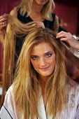 NEW YORK NY - NOVEMBER 13: Model Constance Jablonski prepares backstage
