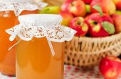 Canned Apple Juice And Apples In Basket