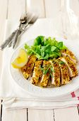 Sliced Lemon Herb Crusted Chicken Breast, Copy Space For Your Text
