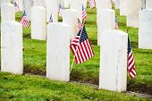 image of arlington cemetery  - White marble headstones with American Flags at Arlington of the West Veterans Memorial Cemetery in Seattle - JPG