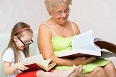 Grandmother And Her Granddaughter Are Reading