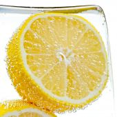 foto of ice-cubes  - Lemon slice in water with bubbles close up - JPG