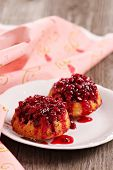 Lingonberry upside down muffins on a plate