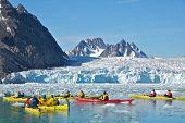 Svalbard, Norway - July 2013: Kayaking Close to Monaco Glacier in Svalbard
